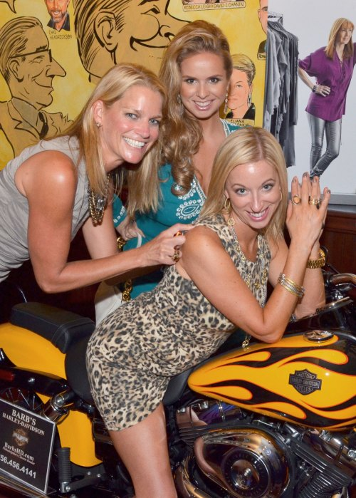 3 women and a yellow HD bike - irresistable