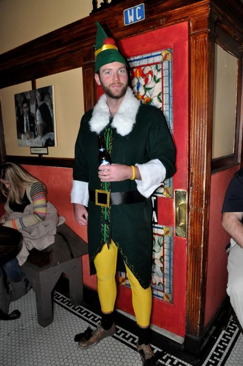 "Beamer the Elf guarding the Men's room  |  PASSWORD:  ""Ho Ho Ho"""